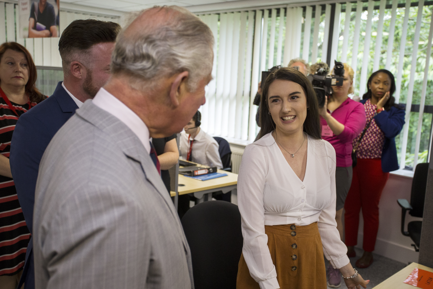 HRH Prince Charles visiting the Princes Trust contact centre and speaking with a member of the team Bethan George